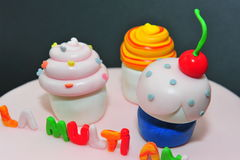 Cupcakes fondant figurines. Beautifully crafted fondant cake figurines for a special birthday stock photo