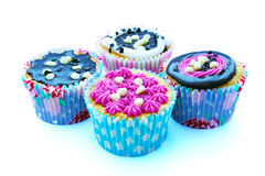Cupcakes. Four cupcakes with chocolate and strawberry topping Stock Images