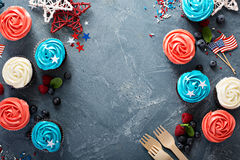 Cupcakes for the Fourth of July. Red, blue and white cupcakes for the Fourth of July overhead shot with copy space royalty free stock images