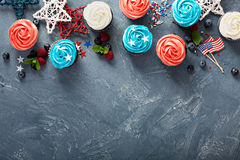 Cupcakes for the Fourth of July. Red, blue and white cupcakes for the Fourth of July overhead shot with copy space stock photography