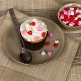 Cupcakes with frosting and hearts Stock Photos
