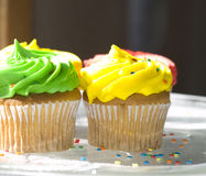 Cupcakes with Frosting and Sprinkles Stock Images