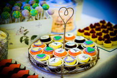 Cupcakes  and fruit tarts Royalty Free Stock Images