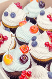 Cupcakes with fruits Royalty Free Stock Images