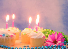 Cupcakes and Gift with Candles Stock Photo