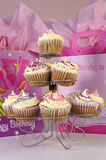 Cupcakes and gifts. Cupcakes and gift bags for a birthday royalty free stock photo