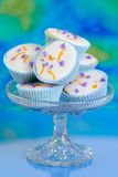 Cupcakes On Glass Comport. Pretty cupcakes on glass comport dish decorated with lavender and orange zest Royalty Free Stock Image
