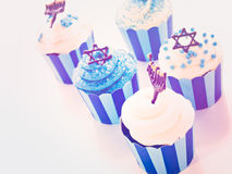 Cupcakes. Gourmet cupcakes decorated with white and blue icing for Hanukkah Royalty Free Stock Photo