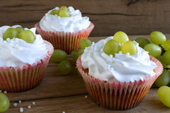 Cupcakes with grapes Stock Photos