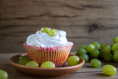 Cupcakes with grapes Royalty Free Stock Images