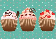 Cupcakes on the green background Stock Photography