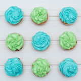 Cupcakes with green and blue cream Royalty Free Stock Photos