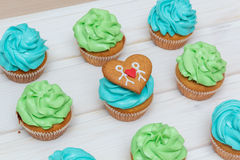 Cupcakes with green and blue cream Royalty Free Stock Images