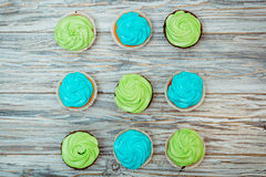 Cupcakes with green and blue cream Royalty Free Stock Image