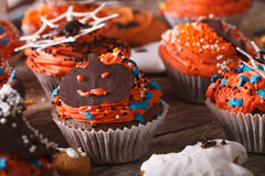 Cupcakes with Halloween jack close-up on the table. horizontal Stock Photos