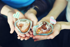 Cupcakes in the hands Stock Photography