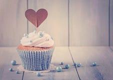 Cupcakes with heart cakepick Royalty Free Stock Photos