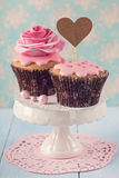 Cupcakes with heart cakepick Royalty Free Stock Photos