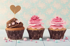 Cupcakes with heart cakepick Royalty Free Stock Images