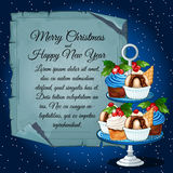 Cupcakes with holly berry and card for your text Royalty Free Stock Photos