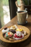 Cupcakes with hot chocolate. On old wooden table Stock Images