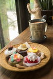 Cupcakes with hot chocolate. On old wooden table Stock Photo