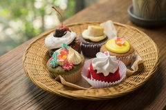 Cupcakes with hot chocolate. On old wooden table Royalty Free Stock Images