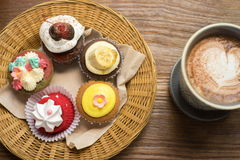 Cupcakes with hot chocolate. On old wooden table Royalty Free Stock Photo