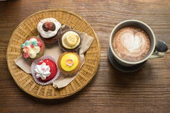 Cupcakes with hot chocolate. On old wooden table Royalty Free Stock Photography