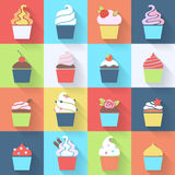 Cupcakes icons set in flat style. Stock Photos