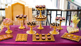 Cupcakes. At an indoor wedding scene Stock Image