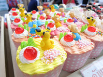 Cupcakes. Kinds of colorful cupcake in cartoon style Stock Photo