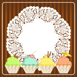 Cupcakes on lace paper background Stock Photography