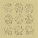 Cupcakes. Line drawing of cupcakes on cardboard Royalty Free Stock Images
