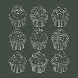 Cupcakes. Line drawing of cupcakes on chalkboard Stock Image