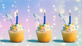 Cupcakes with lit candles royalty free stock images