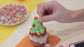 Cupcakes little girl decorate muffin stock video footage
