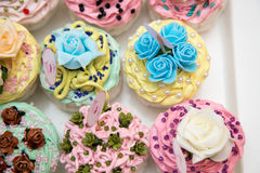 Cupcakes And Macarons. On A Tray As A Wedding Gift stock image