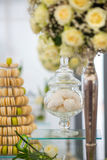 Cupcakes and  Macaroons. Fancy Cupcakes and Pyramid of Colorful Macaroons and Flower Decoration Stock Photos