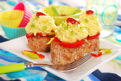 Cupcakes made from minced meat and potato puree for dinner. Cupcakes made from baked minced meat,potato puree and vegetables for dinner Royalty Free Stock Image