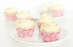 Cupcakes. Making cupcakes. Decorating cupcakes with an icing tube Royalty Free Stock Photography
