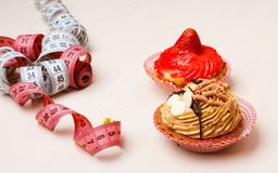 Cupcakes with measuring tape on table Royalty Free Stock Image