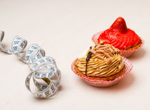 Cupcakes with measuring tape on table Royalty Free Stock Photography