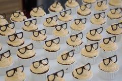 Cupcakes met kaders op bovenkant Stock Fotografie