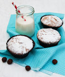 Cupcakes and milk. On a old white wooden background Royalty Free Stock Photo