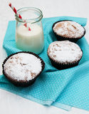 Cupcakes and milk. On a old white wooden background Stock Photo