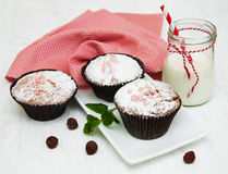 Cupcakes and milk. On a old white wooden background Stock Image