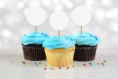 Cupcakes Mockup with Three Blue Frosted Cupcakes