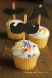 Cupcakes with moustaches Stock Photos