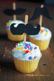 Cupcakes with moustaches Royalty Free Stock Photo
